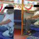 Man using live snake as face mask boards bus in England